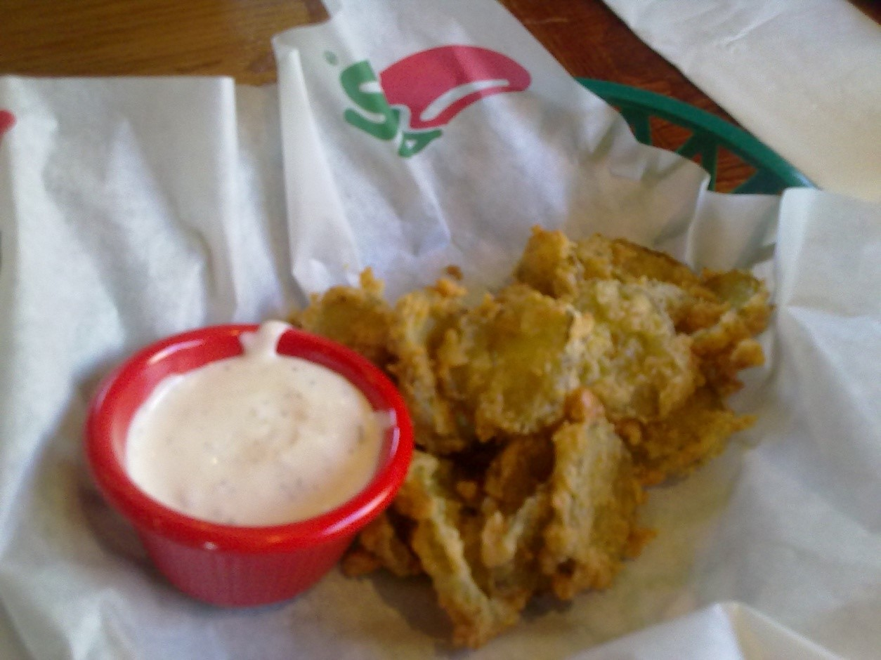 Deep-fried pickles with blue cheese dressing