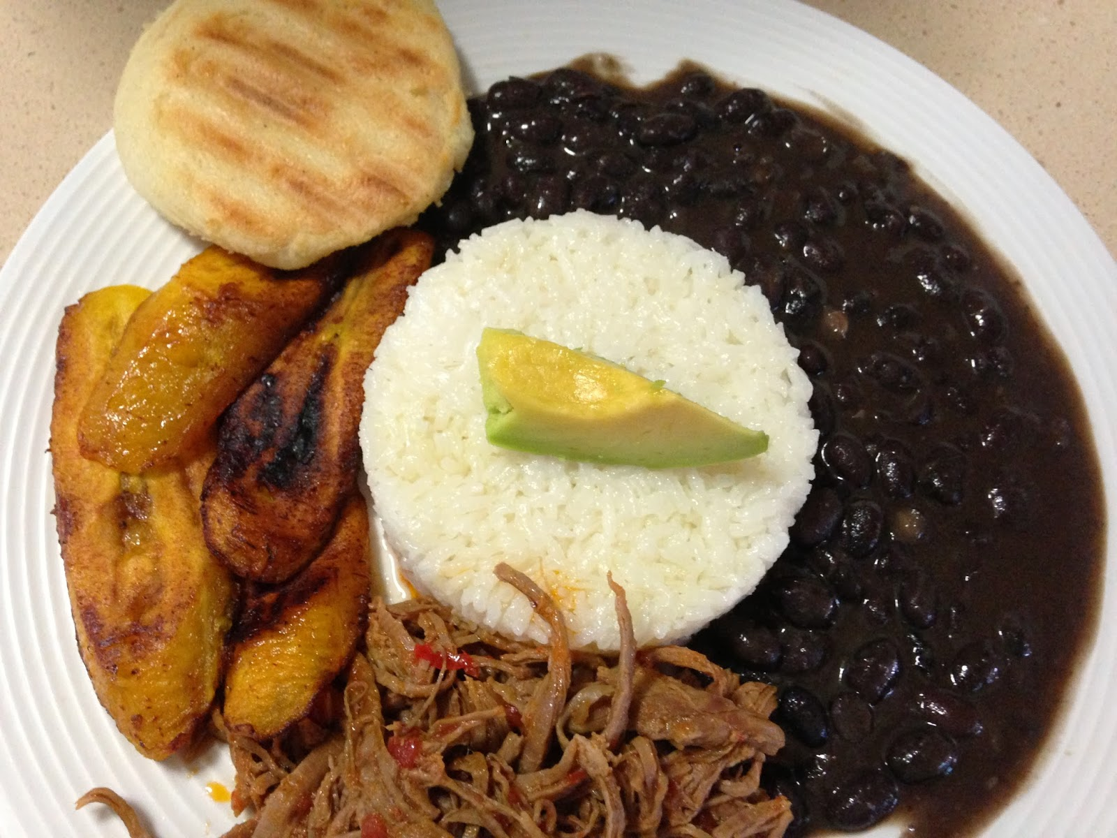 26 traditional venezuelan foods that will make you go slurp 3 pabellon criollo the meaty national dish forumfinder Choice Image