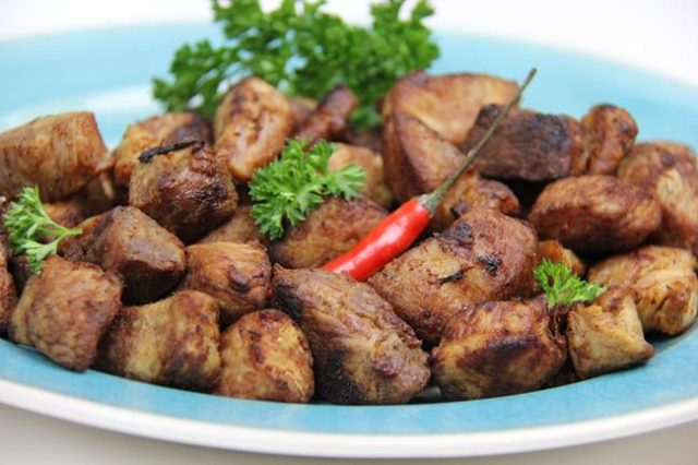 Griot - Cuisine traditionnelle haïtienne avec du porc frit